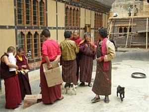 At a temple in Thimphu. Men wearing the traditional Gho