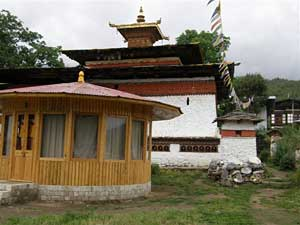 Typical Bhutanese house with prayer flags in Paro