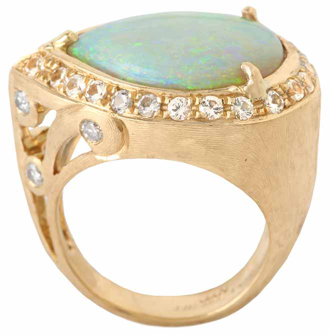 Opal Cocktail Ring by Jessica Surloff. 18K Yellow Gold, Opal and white sapphires.