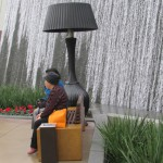 Only in Las Vegas. A waterfalls, a huge lamp and someone waiting with her purchases